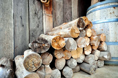 Firewood for heating. Stacked firewood side wall used for home heating Stock Image