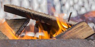 Firewood heating up in the grill Stock Photos