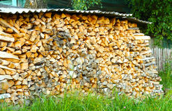 Firewood in a large number of stacked in a pile Stock Photos