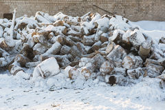 Firewood lie heaped. In the snow in winter Royalty Free Stock Image