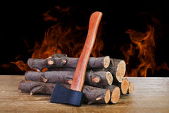 Firewood logs and axe Royalty Free Stock Photos
