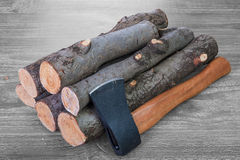 Firewood logs and axe Royalty Free Stock Image