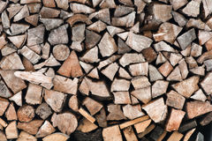 Firewood logs in a pile. Background of dry chopped firewood logs in a pile Stock Photo