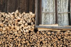 Firewood Logs Under Rustic Wooden House Window Royalty Free Stock Photography