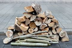Firewood made from aspen and birch wood is built on the granite Stock Photography