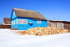 Firewood near building Royalty Free Stock Image