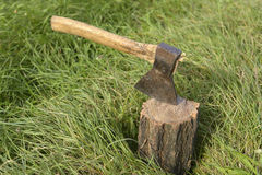 Firewood and old axe Stock Images