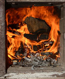 Firewood in the old stove Stock Photography