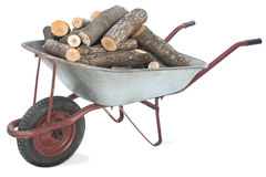 Firewood in an old wheelbarrow Royalty Free Stock Images