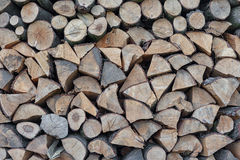 Firewood Outdoor, Brown Background. Dry Chopped Firewood logs in Stock Image