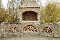 Firewood in an oven in a garden Stock Photo