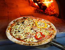 Firewood oven pizza Stock Image