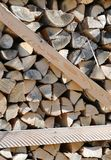 Firewood on the pallet in winter. Lots of firewood on the pallet in winter Stock Photos