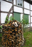 Firewood pile. In front of a half timbered house in Germany Stock Photography