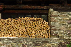 Firewood pile in an alpine hut. Wood stack shed Royalty Free Stock Photo