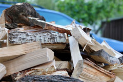 Firewood. A pile of firewood with car on background stock photography