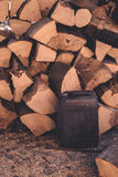 Firewood pile and plastic oil canister Stock Photography