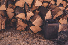 Firewood pile and plastic oil canister Stock Image