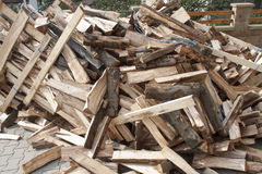 Firewood in a pile, preparing wood for winter Stock Photos