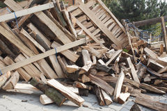 Firewood in a pile, preparing wood for winter Stock Image