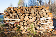 Firewood pile stored outside Royalty Free Stock Photo