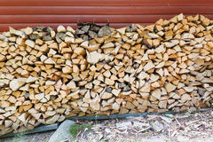 Firewood pile stored outside Stock Photo