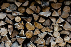 Firewood piled in stack outside Stock Photo