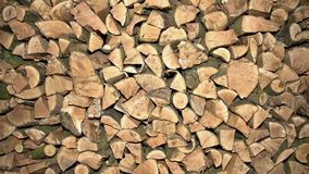 Firewood piled up high, UK. Logs for firewood piled up high in s stack ready for burning for fuel Royalty Free Stock Photos