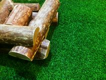 Firewood piles placed on artificial grass stock photo