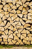 Firewood placed on the ground Royalty Free Stock Images