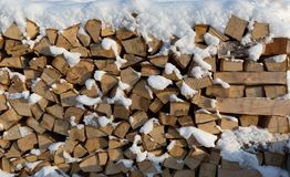 Firewood put. Chipped firewood. Firewood covered with snow Stock Photo