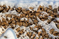 Firewood put. Chipped firewood. Firewood covered with snow Stock Photos