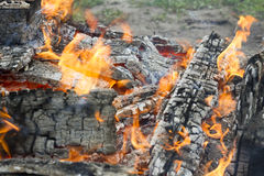 Burning coals on a grill Royalty Free Stock Photos