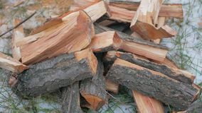 Firewood with a red tint lie stock video