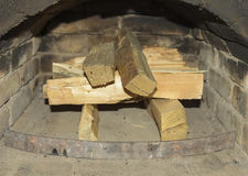 Firewood in the a rustic fireplace. royalty free stock photo
