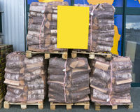 Firewood for sale. In marketplace Royalty Free Stock Photography
