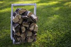 Firewood for sauna. A wooden basket full of firewood for sauna Royalty Free Stock Photo