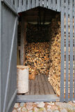 Firewood shed. Wooden shed filled with piles of chopped firewood stock image