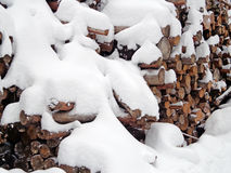 Firewood in the snow Stock Images