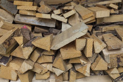 Firewood. Some firewood and an axe for making new firewood Royalty Free Stock Photo