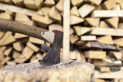 Firewood. Some firewood and an axe for making new firewood Stock Photography