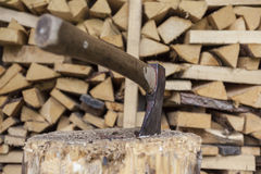 Firewood. Some firewood and an axe for making new firewood Stock Image