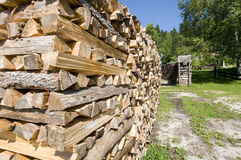 Firewood. Some piles of fire wood in the garden royalty free stock photography
