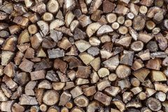Firewood. Stack of wood logs, wooden abstract background stock photo