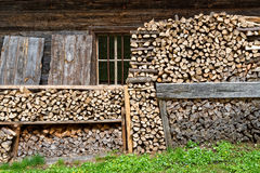 Firewood stacked in a alpine hut Royalty Free Stock Images