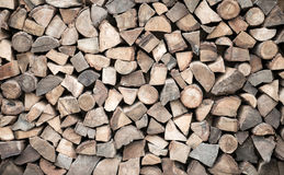 Firewood stacked in heap Stock Image