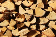 Firewood stacked and piled Royalty Free Stock Images