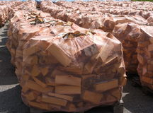 Firewood. Stacked for sale wraped in net Stock Photography