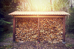 Firewood stacked in shed Royalty Free Stock Photos