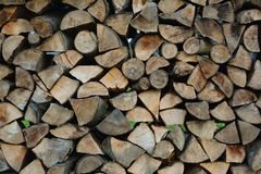 Firewood stacked for storage. Store firewood. Wood burned as fuel. stock photos